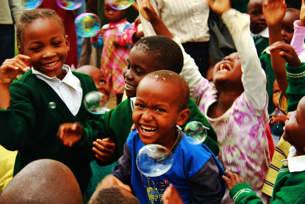 May: Kids playing with bubbles in an informal settlement in Nairobi, Kenya