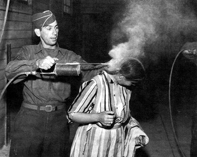 In 1944, a U.S. Army serviceman sprays an Italian woman with DDT (via)