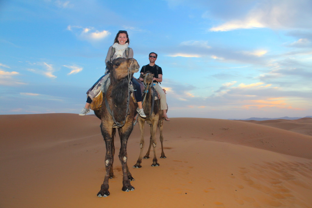 Riding camels at Sunset in the Sahara, in Merzouga